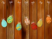 Ovos da páscoa em uma parede de madeira. + EPS8 Fotografia de Stock Royalty Free