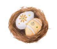 Ovos da páscoa na ilustração da pintura da aquarela do ninho isolada no fundo branco ilustração do vetor