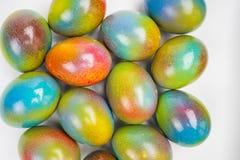 Ovos da páscoa pulverizados coloridos Imagens de Stock