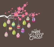 Ovos da páscoa que penduram o fio na árvore ilustração royalty free