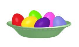 Ovos da páscoa tingidos em uma bacia do verde de ervilha Imagem de Stock