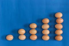 Ovos de Brown na tabela azul Fotografia de Stock
