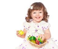 Ovos de Easter bonitos da pintura da menina Imagem de Stock Royalty Free