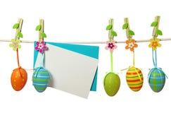 Ovos de Easter e nota em branco Imagens de Stock