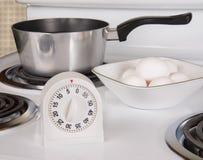 Ovos de ebulição no fogão Imagem de Stock Royalty Free