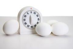 Ovos de ebulição no fogão Fotos de Stock Royalty Free