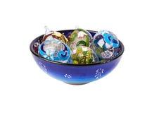 Ovos decorativos do vidro no tampão azul Imagens de Stock