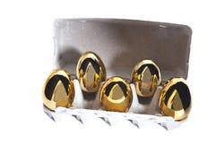 Ovos dourados na caixa Foto de Stock Royalty Free