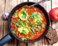 Ovos e tomates de Shakshuka Fotografia de Stock