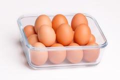 Ovos em uma bacia de vidro Imagens de Stock Royalty Free