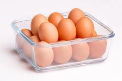 Ovos em uma bacia de vidro Fotografia de Stock