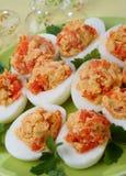 Ovos fervidos com peixes salmon Imagem de Stock
