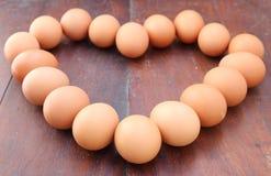 Ovos, forma do coração Foto de Stock