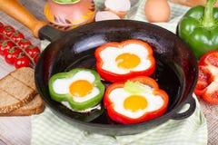 Ovos fritados em uma pimenta Imagem de Stock Royalty Free