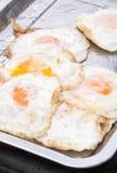 Ovos fritados na bandeja do cozimento Imagens de Stock Royalty Free