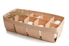 Ovos na caixa isolada Fotos de Stock Royalty Free