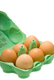 Ovos na caixa isolada no branco Foto de Stock