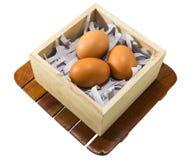 Ovos no caso de madeira Foto de Stock Royalty Free