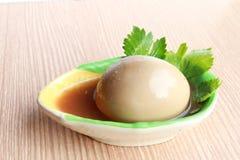 Ovos no molho marrom Fotos de Stock Royalty Free
