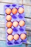 Ovos no recipiente Fotografia de Stock