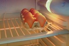 Ovos no refrigerador Imagens de Stock Royalty Free
