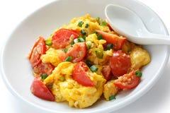 Ovos Scrambled com tomates Foto de Stock