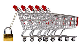 Ow of shopping trolleys secured and isolated Royalty Free Stock Image