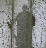 Owain Glyndwr, Welsh hero, silhouette behind drapes. The silhouetted figure of Owain Glyndwr, Welsh hero, seen behind the patterns and folds of muslin drapes Royalty Free Stock Image