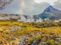 Owakudani hot spring pond with misty and active sulfur vents is. Popular scenic views, volcano activity and black eggs boiled in hot springs at Hakone, Japan royalty free stock images