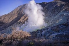 Owakudani still emits volcanic smoke containing hydrogen sulfide everywhere.  royalty free stock photo