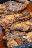 Owen cozeu reforços de carne de porco no molho de vinho Fotografia de Stock Royalty Free