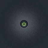 Ower button. Green power button at bumped plastic surface with copy space Royalty Free Stock Photos