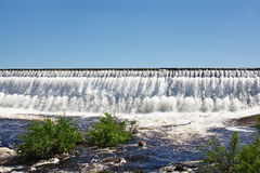 Owerflow of water on the storage pond Stock Photography