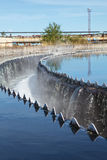 Owerflowing sewage from radial sedimentation tank. On water treatment station Stock Images