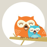 Owl. A happy mother with baby sit tonight branch Royalty Free Stock Photo