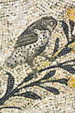 Owl. Ancient roman mosaic of an owl, symbol of wisdom, maker of predictions and symbol of the goddees Athene part of the UNESCO listed basilica of Aquileia in Royalty Free Stock Photos