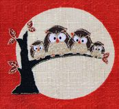 Japanese Owl. Four owls resting on tree fabric print which represents happiness, long life and wisdom in Japanese culture Stock Image