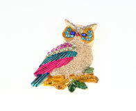 Owl adorned with precious stones. Stock Images