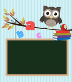 Owl back to school. /Little brown owl on branch with chalkboard,letters and books Stock Photo