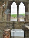 Owl in a barn with church like windows Stock Photos