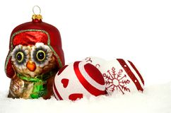 Owl and baubles in snow. Christmas background with owl and baubles in snow Stock Images