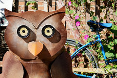 Owl and Blue Bike stock images