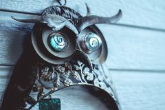 Owl, Broken Wind Chime, outside of House on Patio Walls. With bokeh background. Shot during the golden hour on a cloudy day on the Colorado Front Range stock photos