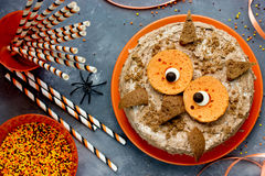 Owl cake. Halloween or birthday party dessert, delicious cream c. Ake in the form of an funny owl. Halloween cake on a festive decorated table, creative idea for stock photo