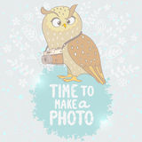 Owl and camera Stock Photography