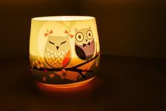 Owl candle shining Stock Images