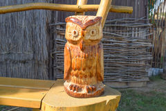 Owl carved from wood. Woodcarving. Beautiful owl figurine of logs Royalty Free Stock Photo