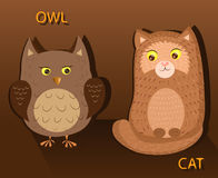 Owl and Cat opposite each other. Owl and a cat sitting in front and looking at each other Royalty Free Stock Photo