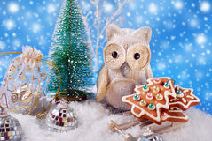 Owl with christmas gingerbread cookies on sledge Stock Photo