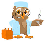 Owl doctor holding syringe. Owl veterinarian in white coat Royalty Free Stock Images